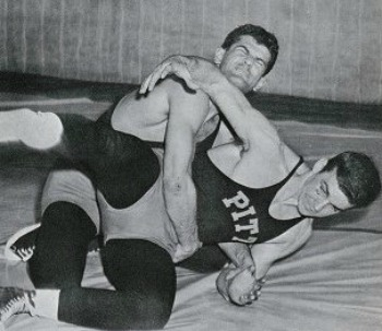 Joe Solomon (behind) won an NCAA Championship at 167 pounds in 1954.
