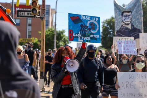 Protestors march in East Liberty in response to the death of George Floyd.