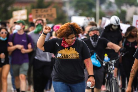 Protesters march across the Birmingham Bridge during a protest on June 4.