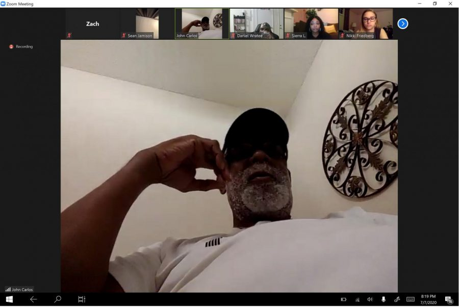 John Carlos spoke to about 30 Pitt students and faculty on Tuesday night about his life and experience at the 1968 Olympics in Mexico City.