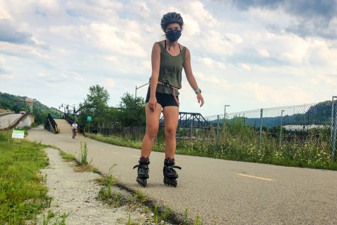 Opinions editor Leah Mensch has spent much of her free time this summer rollerblading on the South Side trail.