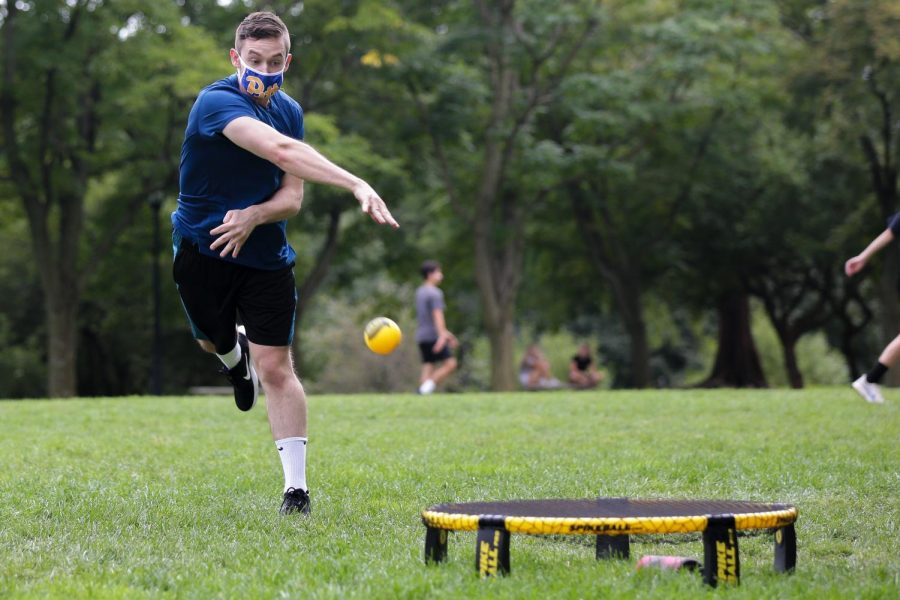 Members of the Panther Roundnet club practice spikeball on the Cathedral lawn on Monday afternoon.