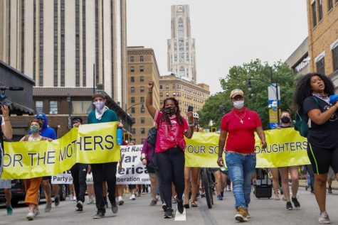 After 70 days of her hunger strike, Dannielle Brown marched Friday alongside Pittsburgh activists from Chatham University with stops at Carnegie Mellon University, Pitt and Carlow University before ending at Duquesne University's Brottier Hall to honor her son.