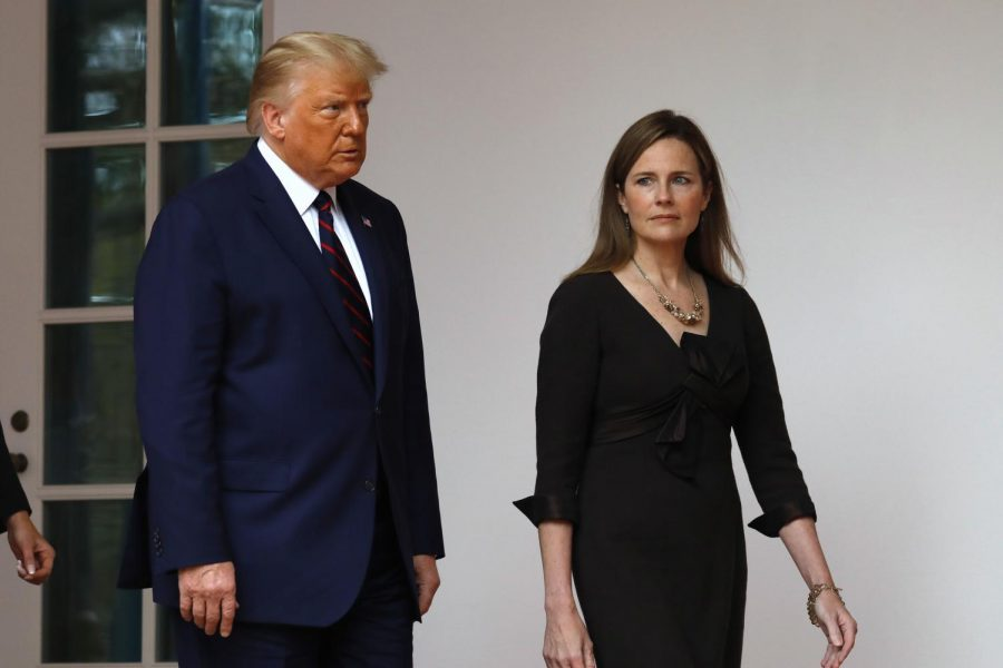 President+Donald+Trump+arrives+with+Judge+Amy+Coney+Barrett+to+introduce+her+as+his+Supreme+Court+Associate+Justice+nominee+in+the+Rose+Garden+of+the+White+House+on+Sept.+26.+