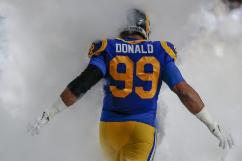 Los Angeles Rams defensive tackle Aaron Donald is shrouded in pregame fog before taking on the Seattle Seahawks at the Los Angeles Memorial Coliseum on December 8, 2019.
