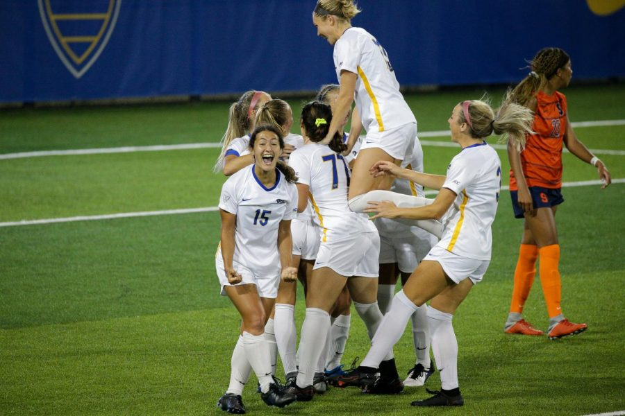 The+womens%27+soccer+team+celebrates+after+scoring.+Pitt%E2%80%99s+men%E2%80%99s+and+women%E2%80%99s+soccer+programs+both+received+their+highest+ranking+in+school+history+from+the+United+Soccer+Coaches+Wednesday.+