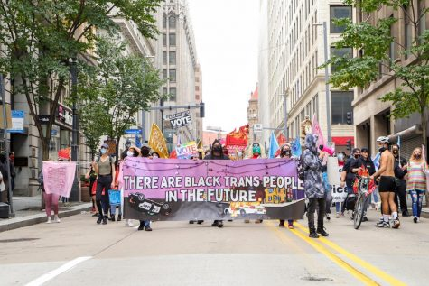 "SisTersPGH hosted a Sunday march from Freedom Corner to Allegheny Commons Park as part of ""People's Pride PGH 2020: Black Trans Lives Matter Too."""
