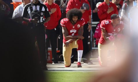 Colin Kaepernick of the San Francisco 49ers kneels for the national anthem at Levi