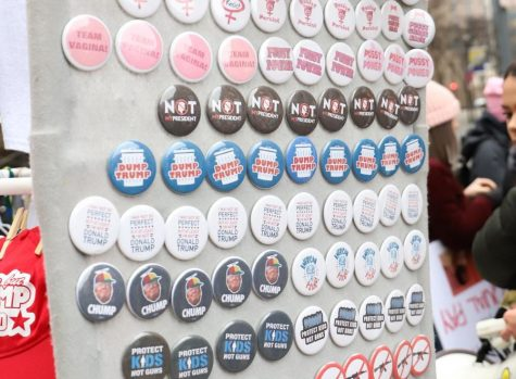Magnets and buttons for sale are displayed at the 2019 Pittsburgh Womens' March.