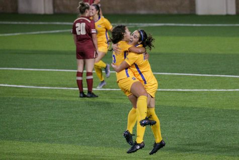 Junior forward Anna Rico (77) celebrates with teammate Chloe Minas (15) after putting up Pitt