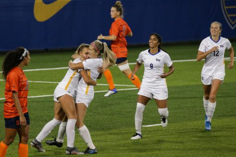 Sophomore forward Amanda West (9) celebrates with her teammates after scoring a goal on Syracuse during Pitt's 2-0 victory over the Orange on Sept. 17.