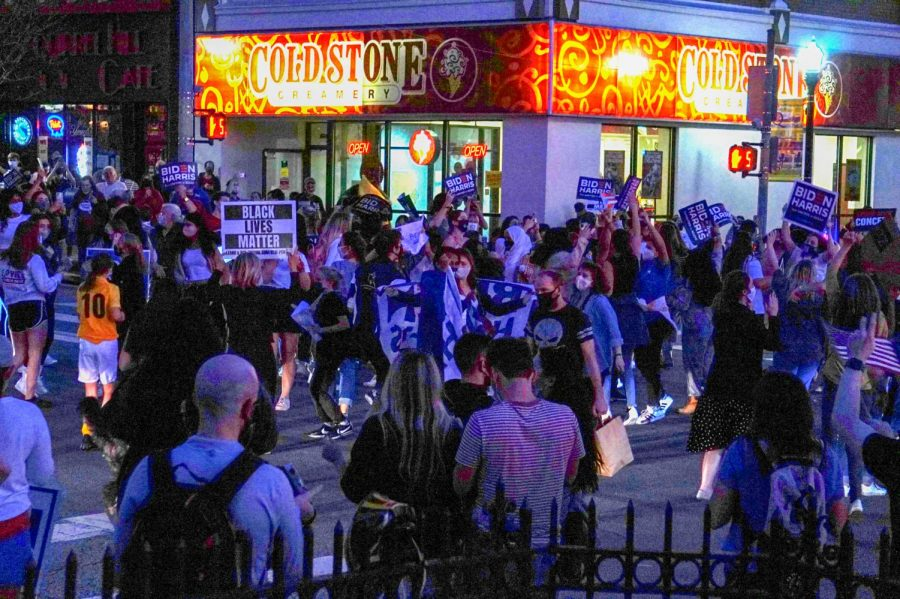 People celebrate and dance in the street in Squirrel Hill after learning about Biden's election win.