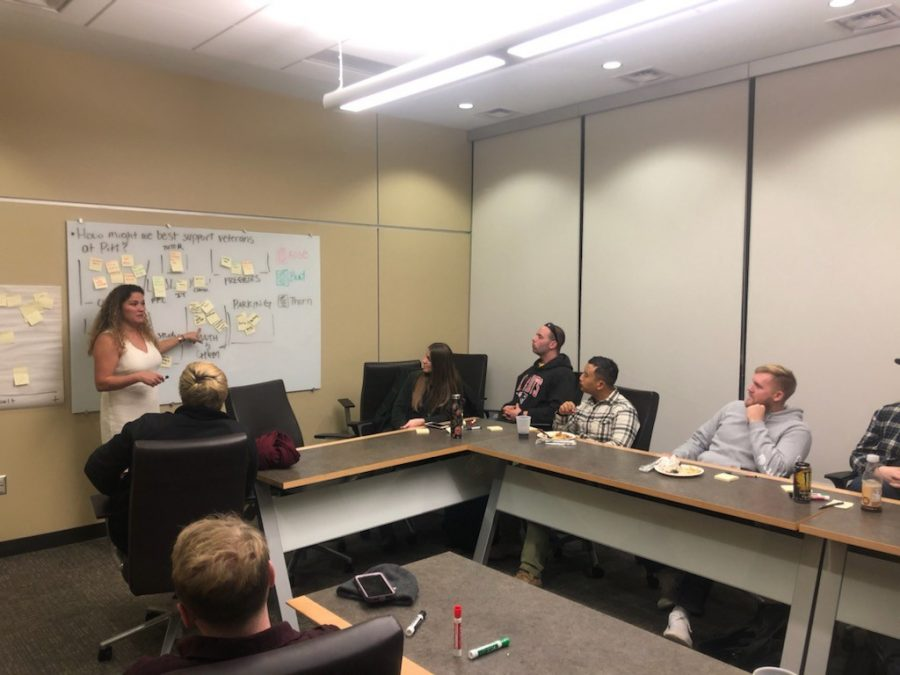 """Aryanna Berringer, director of the Office of Veterans Services, works with a """"Master the University"""" class last year."""