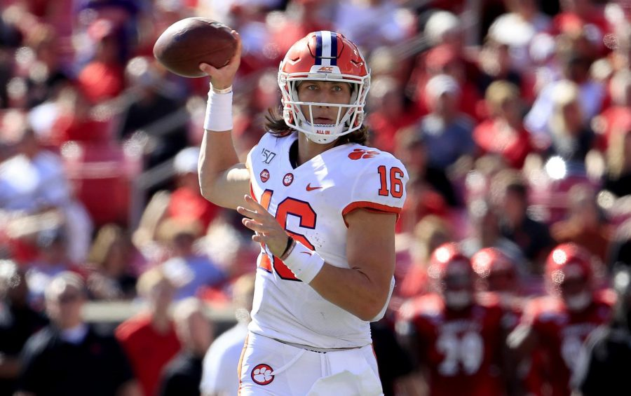 Clemson+quarterback+Trevor+Lawrence+throws+a+touchdown+pass+against+Louisville+on+Oct.+19+at+Cardinal+Stadium+in+Louisville%2C+Kentucky.+Lawrence+was+out+last+week+against+Boston+College+due+to+COVID-19+protocol.+
