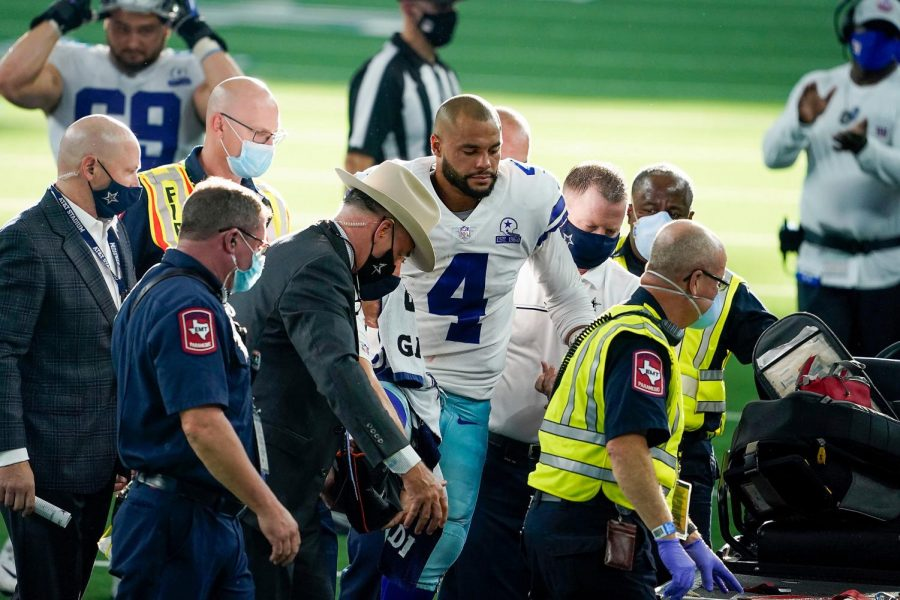 Dallas Cowboys quarterback Dak Prescott (4) leaves the field on a cart after being injured on a tackle by New York Giants cornerback Logan Ryan at AT&T Stadium in Arlington, Texas, on Oct. 11.