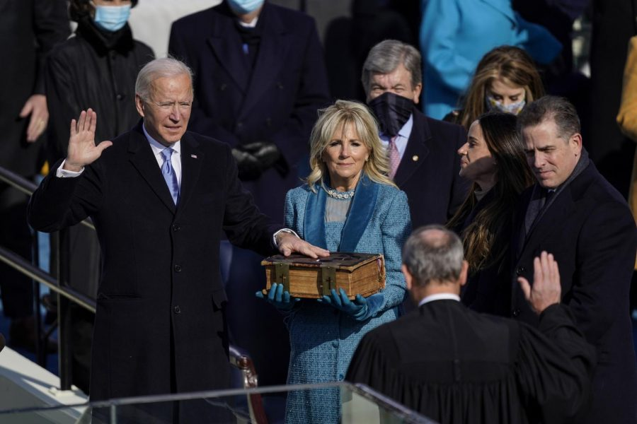 President Joe Biden takes the oath of office from Supreme Court Chief Justice John Roberts as his wife, first lady Jill Biden, stands next to him during the 59th presidential inauguration in Washington, D.C., on Wednesday. (Kent Nishimura/Los Angeles Times/TNS)