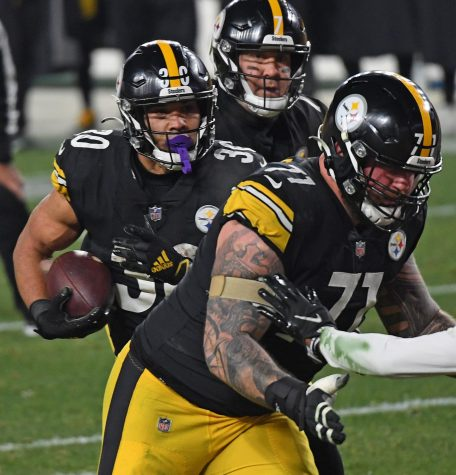 Pittsburgh Steelers running back James Conner scores in the first half against the Cleveland Browns during the NFL wild card playoff game on Sunday, Jan. 10, 2021, at Heinz Field in Pittsburgh, Pennsylvania.