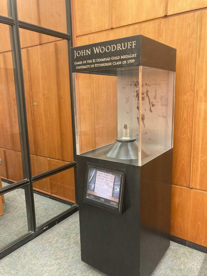 Woodruff's gold medal sits on display on the first floor of the Hillman Library.