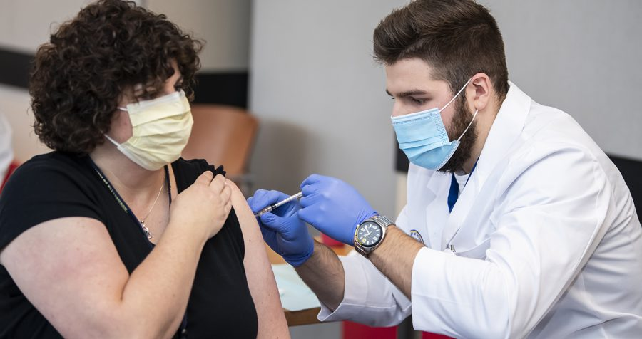 Second-year pharmacy student Jake Murawski administered his first dose of the Pfizer vaccine in December at UPMC Presbyterian, making him the first pharmacy intern in Pennsylvania to administer a COVID-19 vaccine.
