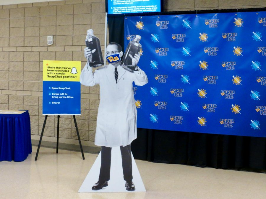 A cardboard cutout of Jonas Salk, inventor of the polio vaccine, stands in the Petersen Events Center on the first day of COVID vaccine administration.