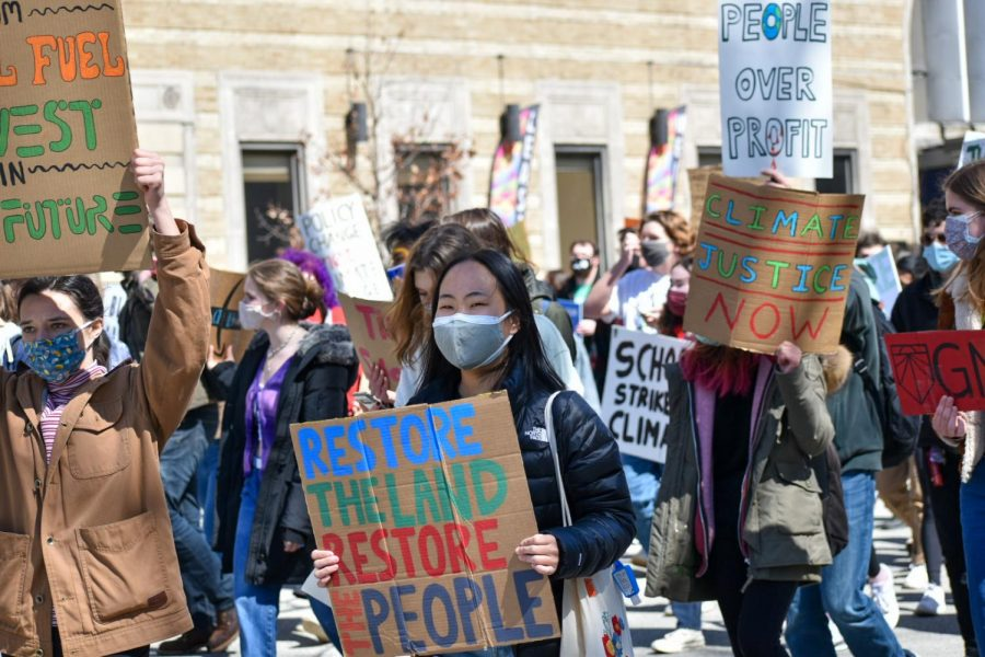 More+than+200+protesters+marched+through+Oakland+on+Friday+afternoon+during+a+climate+strike+rally%2C+urging+climate+justice+and+fossil+fuel+divestment.+Organized+by+Sunrise+Movement+Pittsburgh%2C+the+protest+started+on+Flagstaff+Hill+before+protesters+walked+to+the+Cathedral+of+Learning.
