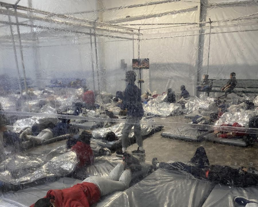 A photo provided by the office of Rep. Henry Cuellar, D-Texas, shows detainees in a Customs and Border Protection overflow facility in Donna, Texas, on March 20.