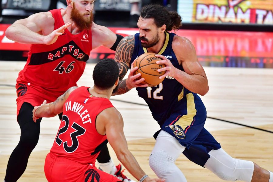 The New Orleans Pelicans' Steven Adams (12) drives to the net during the second half against the Toronto Raptors' Aron Baynes (46) and Fred VanVleet (23) at Amalie Arena in Tampa, Florida, on Dec. 23, 2020.