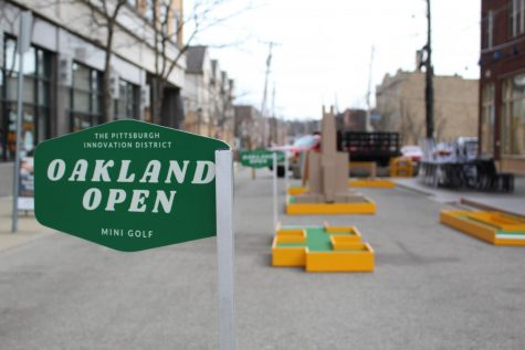 The Oakland Open, a mini golf course installed by the Pittsburgh Innovation District on Oakland Avenue, is intended to generate business for local eateries and restaurants.