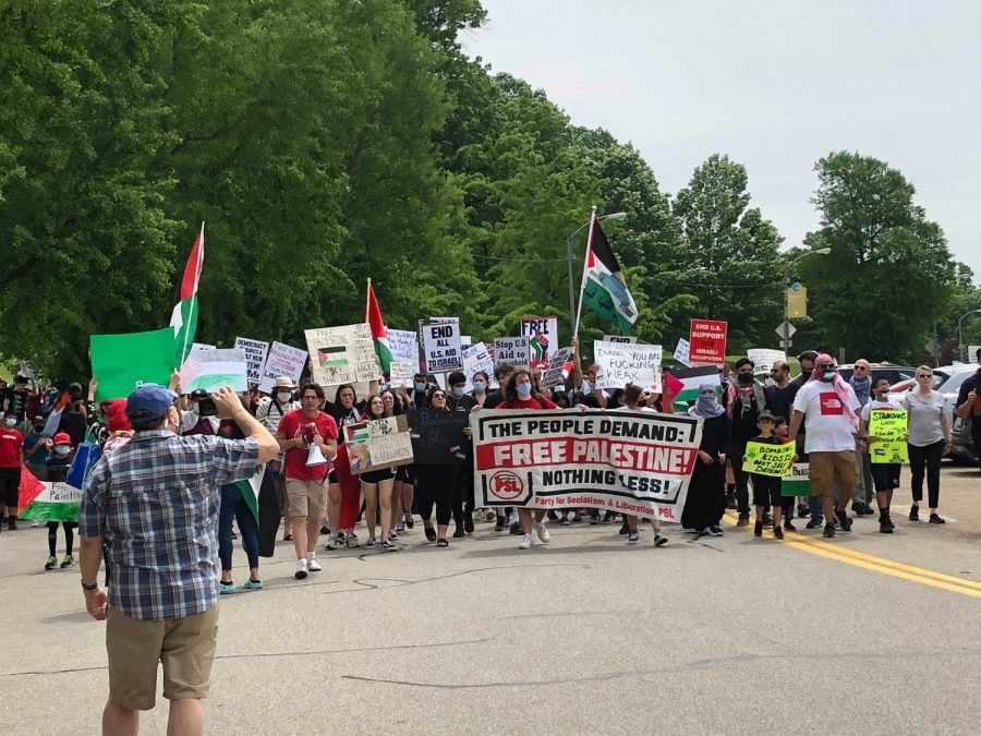 """The crowd of over 100 protestors gathered at Flagstaff Hill on Saturday afternoon carrying """"Free Palestine"""" signs and Palestinian flags as they marched to Schenley Plaza. The protest was organized in reaction to the recent escalation in violence in Israel and Gaza over the past two weeks."""