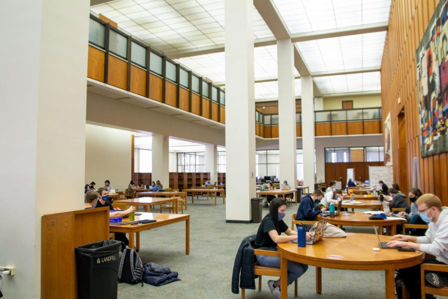 Students study on the first floor of Hillman Library.