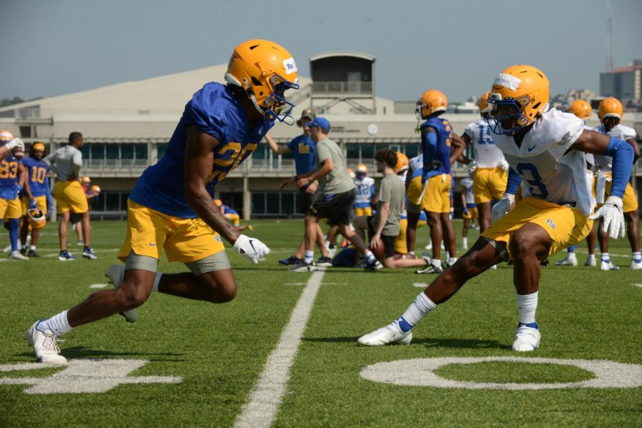 Myles Alston, a first-year wide receiver at left, faces off against Khalil Anderson, a first-year defensive back at right.