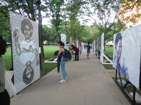 The Black Lives in Focus initiative aims to celebrate and showcase Black lives, voices and experiences in an engaging and direct way. As part of one of their exhibitions, various artwork is now on large scale display along the Omicron Delta Kappa walkway of the Cathedral lawn.