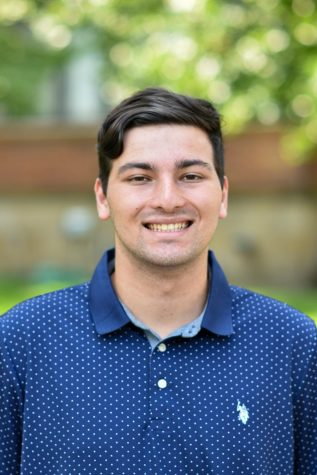 """Mark Santora, a junior biology and classics major, is the club president of RollPlayers. RollPlayers is an on-campus organization dedicated to playing tabletop role-playing games such as """"Dungeons and Dragons."""""""