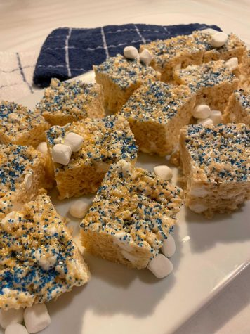 While beer and chips are no-preparation-required staples, you can spice up old classics or show your school spirit with these improved tailgate recipes, such as these blue and gold Rice Krispies Treats.