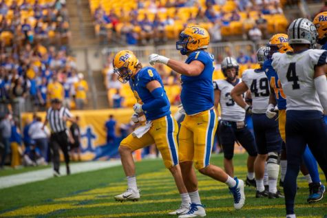 Quarterback Kenny Pickett and tight end Lucus Krull celebrate during Saturdays Homecoming game against the New Hampshire Wildcats at Heinz Field.