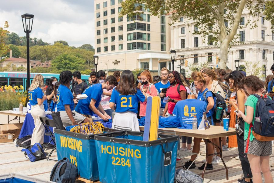 Students+in+Pitt%E2%80%99s+Blue+and+Gold+Society+handed+out+free+Homecoming+T-shirts+at+the+Homecoming+kick-off+event+held+at+the+William+Pitt+Union+plaza+between+noon+and+2+p.m+on+Monday.