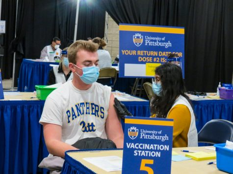 Students, pictured, at a late January vaccination clinic hosted by Pitt and the Allegheny County Health Department. More than 400 faculty members sent an open letter over the summer to Chancellor Patrick Gallagher in support of a COVID-19 vaccine mandate for the safety of the University community.
