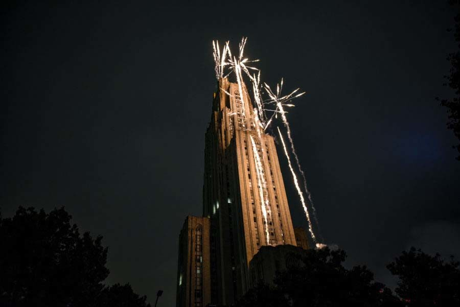 The Cathedral of Learning during a past Homecoming fireworks and laser show.