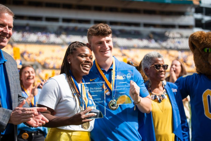 DeJovia Davis (left) and Ian Montelius (right) receive the Spirit of Pitt awards at Saturdays Homecoming game at Heinz Field.