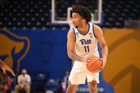 Former Pitt forward Justin Champagnie signed a two-way contract with the Toronto Raptors and saw his first professional action last month at the Las Vegas Summer League.