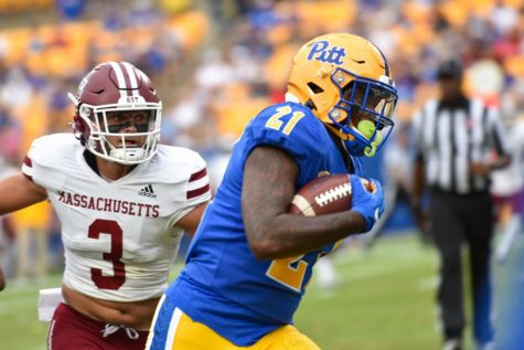 A.J. Davis Jr., a redshirt senior running back, receives and runs the football for a 12-yard touchdown during the UMass game Saturday afternoon.