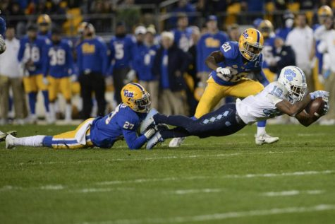 Bricen Garner makes a shoelace tackle while playing for Pitt in 2017.