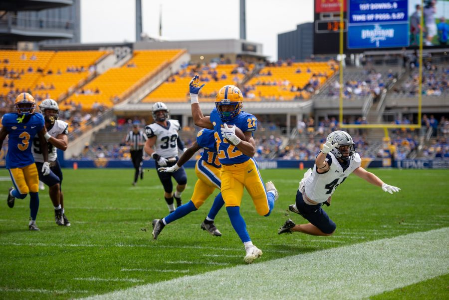 Pitt Panther Vincent Davis carries the ball down the sideline during the Pitt vs. UNH football game.