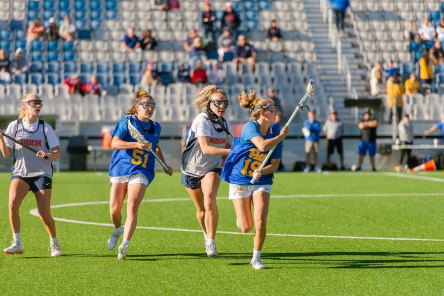 First year midfielder Talia Zuco (19) and Dylana Williams (51). Pitt womens lacrosse broke into its new venue at Highmark Stadium on Sunday morning with its first-ever playday against the Duquesne Dukes.
