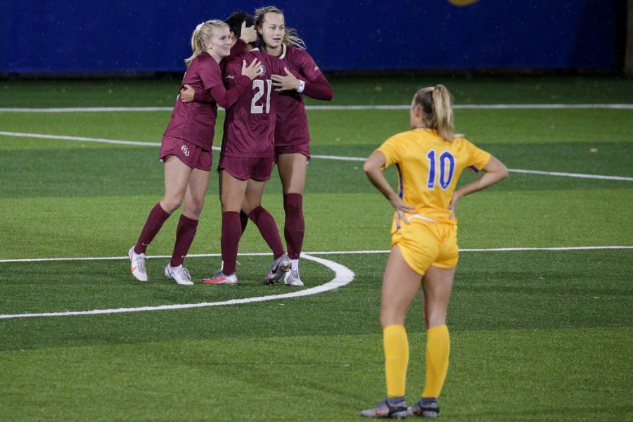 Pitt women's soccer lost 5-0 against the No. 1 Florida State Seminoles Thursday night in Tallahassee. In this file photo, second year midfielder Emily Yaple (10) watches FSUs players celebrate after scoring their third goal on Pitt last year.
