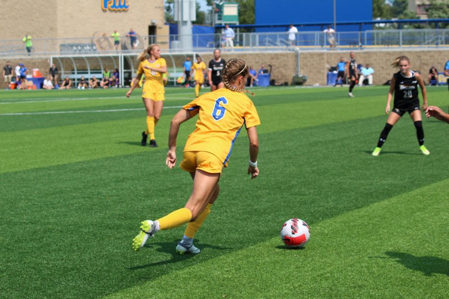 No. 20 Pitt women's soccer completed its three-game homestand with a 2-0 victory over the Towson Tigers on a clear Sunday afternoon. They finished their non-conference schedule with a 7-1 record. Pictured is junior forward Landy Mertz dribbling the ball.