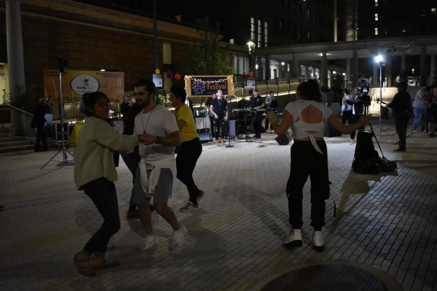 Students dance to the band Karibe Son in front of the William Pitt Union on Saturday night at the annual Latin American and Caribbean Festival hosted by Pitt's Center for Latin American Studies. The festival included live music, business stands and free tacos.