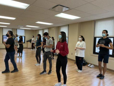 Members of Pitt's salsa club practice in room 501 in the William Pitt Union.