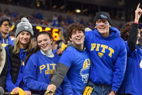 Students pose for a photo at the football game Saturday.