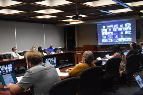 Pitt Faculty Assembly members discuss criteria used to assess professors' scholarly pursuits on Wednesday. Members voted in favor of a dependent care committee and an academic freedom resolution.